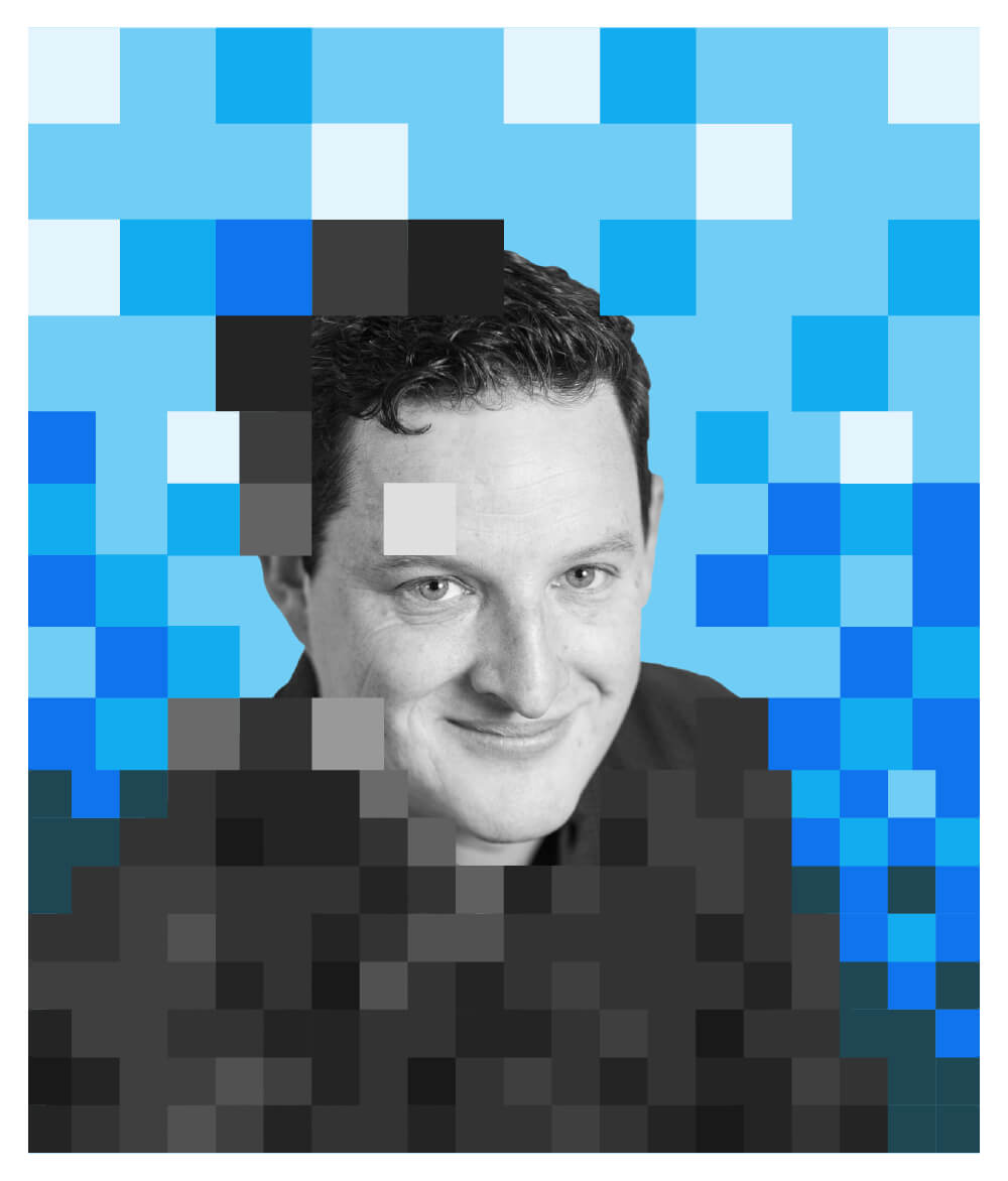 Mat Patterson surrounded by blue pixels